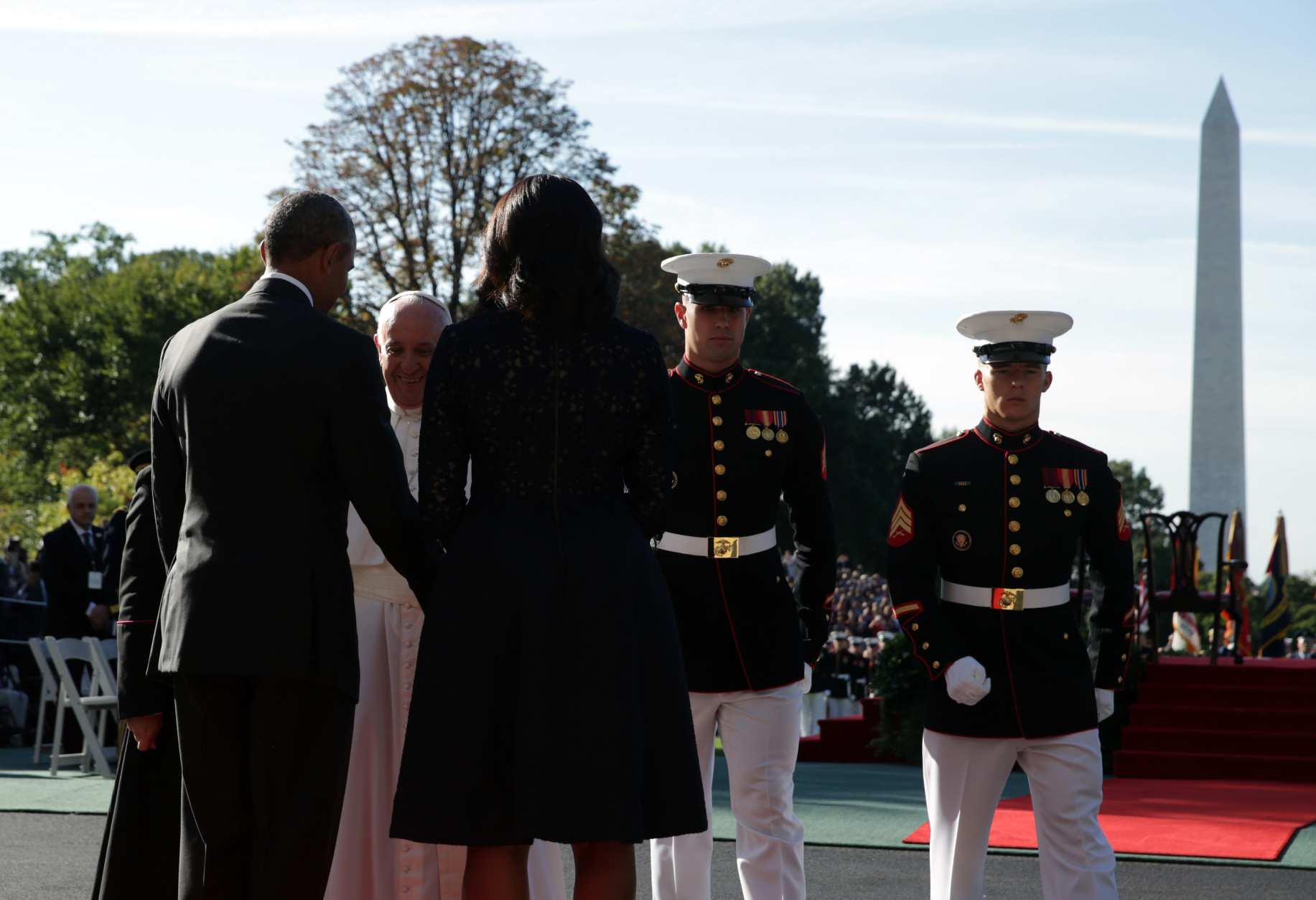 WASHINGTON, DC - SEPTEMBER 23:  U.S. President Barack Obama and first Lady Michelle Obama welcome Pope Francis in an arrival ceremony at the White House on September 23, 2015 in Washington, DC. The Pope begins his first trip to the United States at the White House followed by a visit to St. Matthew's Cathedral, and will then hold a Mass on the grounds of the Basilica of the National Shrine of the Immaculate Conception.  (Photo by Alex Wong/Getty Images)