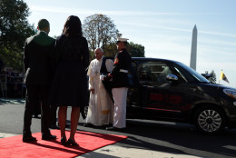 WASHINGTON, DC - SEPTEMBER 23:   Pope Francis exits his car to greet the U.S. President Barack Obama and first Lady Michelle Obama in an arrival ceremony at the White House on September 23, 2015 in Washington, DC. The Pope begins his first trip to the United States at the White House followed by a visit to St. Matthew's Cathedral, and will then hold a Mass on the grounds of the Basilica of the National Shrine of the Immaculate Conception.  (Photo by Alex Wong/Getty Images)