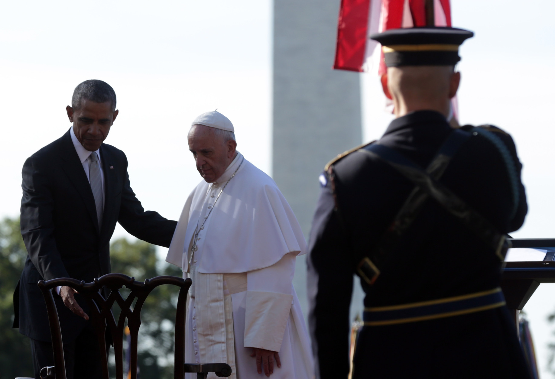WASHINGTON, DC - SEPTEMBER 23:  U.S. President Barack Obama (L) guides Pope Francis (C) to his chair during his arrival ceremony at the White House on September 23, 2015 in Washington, DC. The Pope begins his first trip to the United States at the White House followed by a visit to St. Matthew's Cathedral, and will then hold a Mass on the grounds of the Basilica of the National Shrine of the Immaculate Conception.  (Photo by Alex Wong/Getty Images)