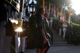 WASHINGTON, DC - SEPTEMBER 23:  U.S. President Barack Obama and first Lady Michelle Obama walk out to welcome Pope Francis prior to his arrival ceremony at the White House on September 23, 2015 in Washington, DC. The Pope begins his first trip to the United States at the White House followed by a visit to St. Matthew's Cathedral, and will then hold a Mass on the grounds of the Basilica of the National Shrine of the Immaculate Conception.  (Photo by Alex Wong/Getty Images)