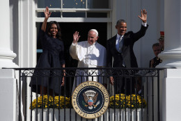 WASHINGTON, DC - SEPTEMBER 23:  U.S. President Barack Obama (R) and first Lady Michelle Obama (L) wave from the balcony with Pope Francis (C) in an arrival ceremony at the White House on September 23, 2015 in Washington, DC. The Pope begins his first trip to the United States at the White House followed by a visit to St. Matthew's Cathedral, and will then hold a Mass on the grounds of the Basilica of the National Shrine of the Immaculate Conception.  (Photo by Win McNamee/Getty Images)