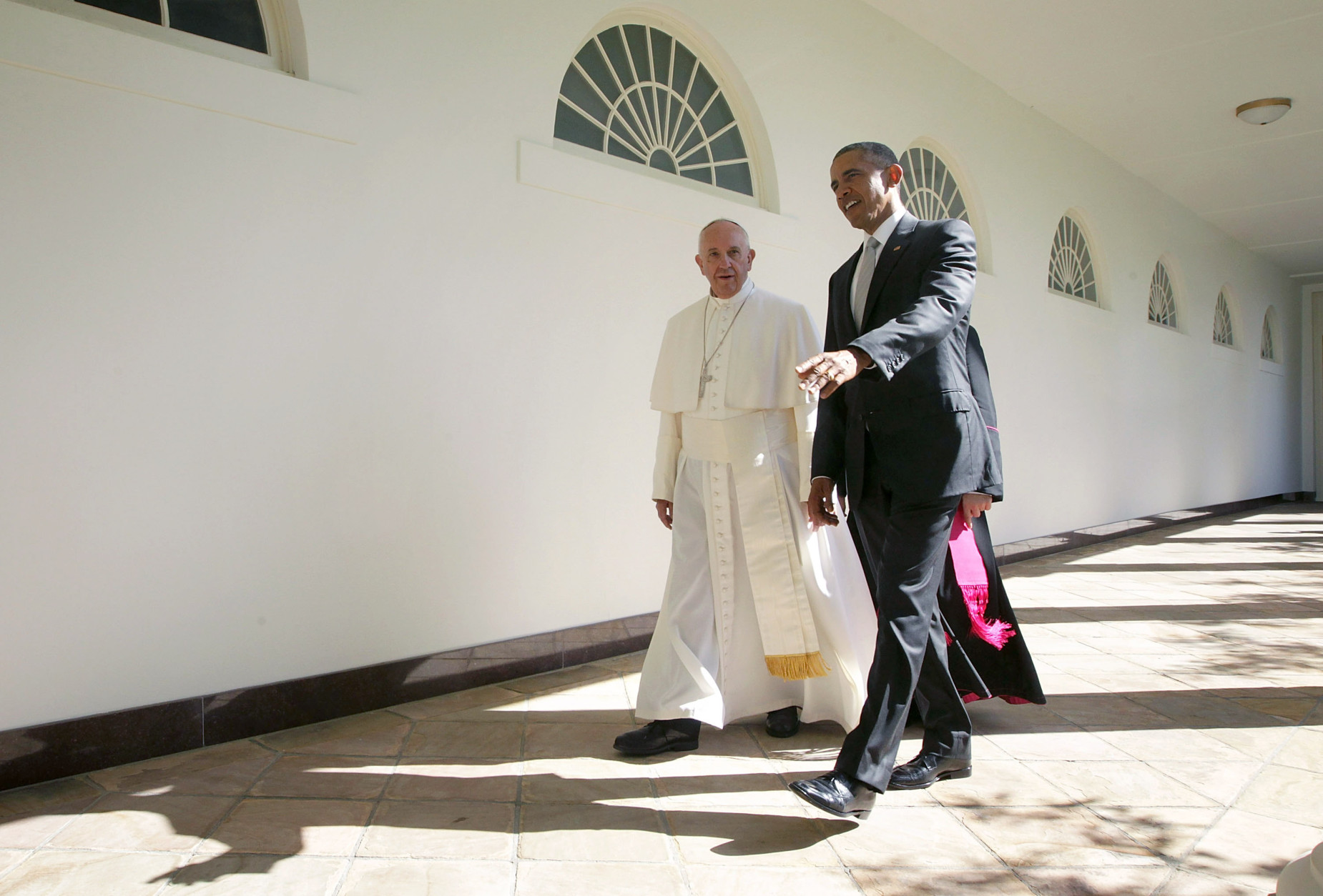 WASHINGTON, DC - SEPTEMBER 23:  U.S. President Barack Obama (R) and Pope Francis (L) walk through the colonnade prior to an Oval Office meeting at the White House on September 23, 2015 in Washington, DC. The Pope begins his first trip to the United States at the White House followed by a visit to St. Matthew's Cathedral, and will then hold a Mass on the grounds of the Basilica of the National Shrine of the Immaculate Conception.  (Photo by Alex Wong/Getty Images)