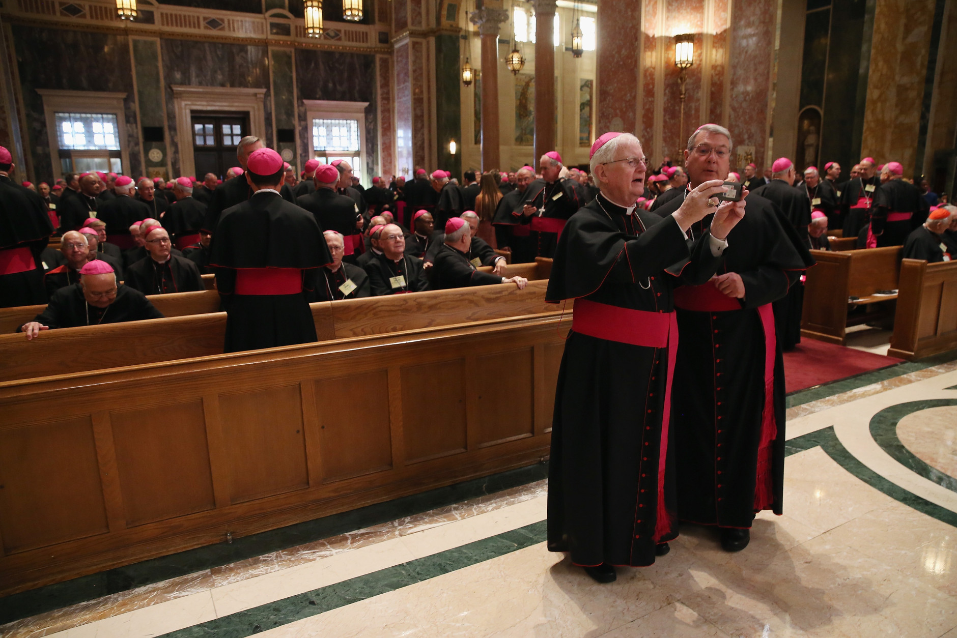 WASHINGTON, DC - SEPTEMBER 23:  Bishop J. Kevin Boland (L) and Bishop Gregory J. Hartmayer (R), from Savannah, Georgia, take a photo prior to the midday prayer service at the Cathedral of St. Matthew on September 23, 2015 in Washington, DC. The Pope began his first trip to the United States at the White House followed by a visit to St. Matthew's Cathedral, and will then hold a Mass on the grounds of the Basilica of the National Shrine of the Immaculate Conception. (Photo by Mark Wilson/Getty Images)