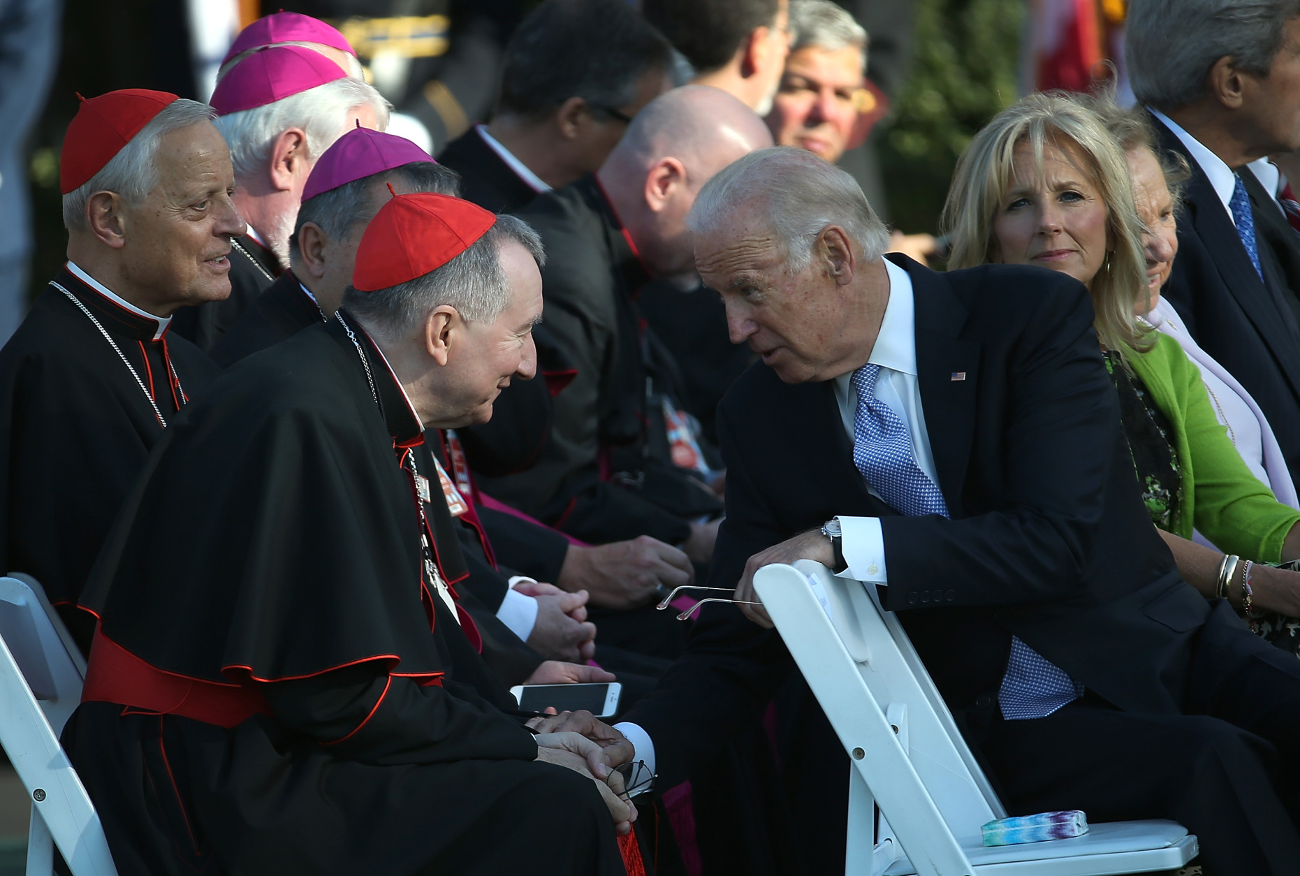 WASHINGTON, DC - SEPTEMBER 23:  U.S. Vice President Joe Biden speaks with members of the clergy before the start of an arrival ceremony for Pope Francis at the White House on September 23, 2015 in Washington, DC. The Pope begins his first trip to the United States at the White House followed by a visit to St. Matthew's Cathedral, and will then hold a Mass on the grounds of the Basilica of the National Shrine of the Immaculate Conception.  (Photo by Win McNamee/Getty Images)