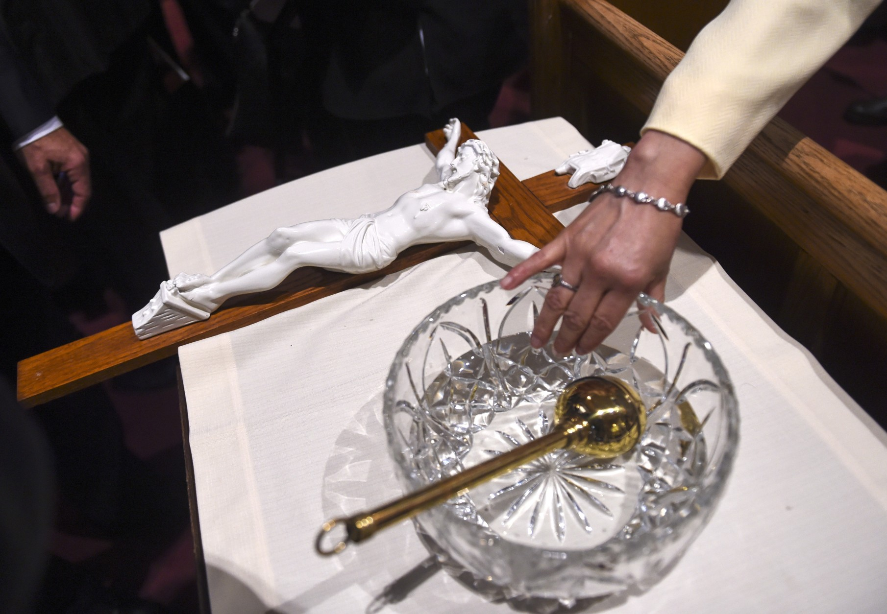 WASHINGTON, DC - SEPTEMBER, 23: A lady dips her finger in the holy water bowl that Pope Francis used to bless the crowd during Midday Prayer of the Divine with more than 300 U.S. Bishops at the Cathedral of St. Matthew the Apostle on September 23, 2015 in Washington, DC. The Pope is on a three-day visit of Washington, D.C. as part of a larger visit to the U.S. (Photo by Jonathan Newton-Pool/Getty Images)