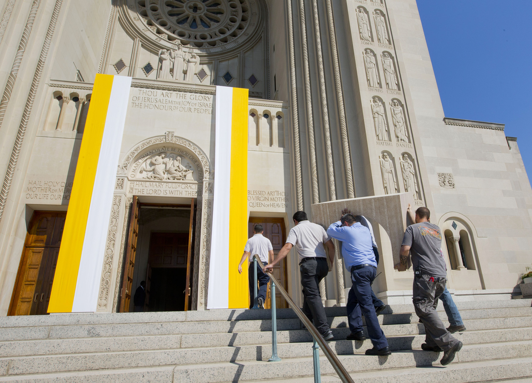 Worker carry a portion of the altar that Pope Francis will use for next week's mass, up the stair and to be assembled at Basilica of the National Shrine of the Immaculate Conception in Washington, Thursday, Sept. 17, 2015.(AP Photo/Pablo Martinez Monsivais)