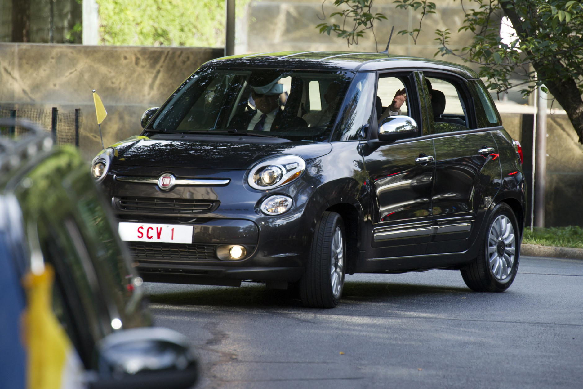 Pope Francis arrives at the Apostolic Nunciature, the Vatican's diplomatic mission in the heart of Washington, Tuesday, Sept. 22, 2015, in a Fiat 500. Pope Francis will visit the White House on Wednesday, becoming only the third pope to visit the White House. (AP Photo/Cliff Owen)