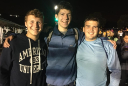 """Ryan, Jackson and  Cameron say they're here for a once-in-a-lifetime event. They say they're """"not even Catholic; we're two Jews and a gay!"""" (WTOP/Kristi King)"""