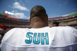 Miami Dolphins defensive tackle Ndamukong Suh looks at the field during pre-game warm ups before the start of an NFL football game against the Washington Redskins on Sunday, Sept. 13, 2015, in Landover, Md. (AP Photo/Evan Vucci)