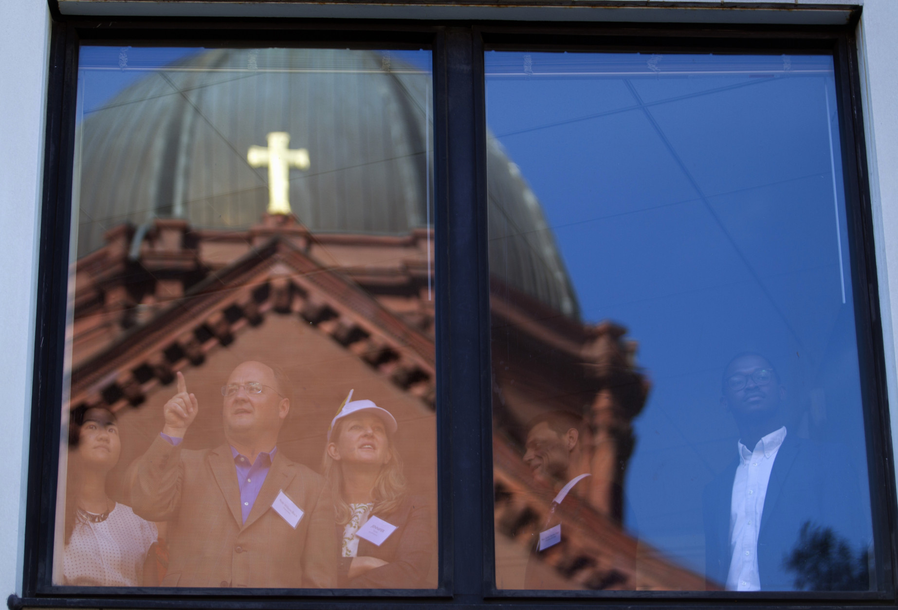 St. Mathews Cathedral is reflected in a nearby building as onlookers wait for Pope Francis to arrive for midday prayer service at the cathedral in Washington, Wednesday, Sept. 23, 2015. ( AP Photo/Jose Luis Magana)St. Mathews Cathedral