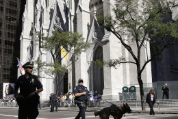 New York Police officers patrol Fifth Avenue in front of St. Patrick's Cathedral in preparation for Pope Francis' arrival to lead an evening prayer service, Thursday, Sept. 24, 2015, in New York. (AP Photo/Julie Jacobson)