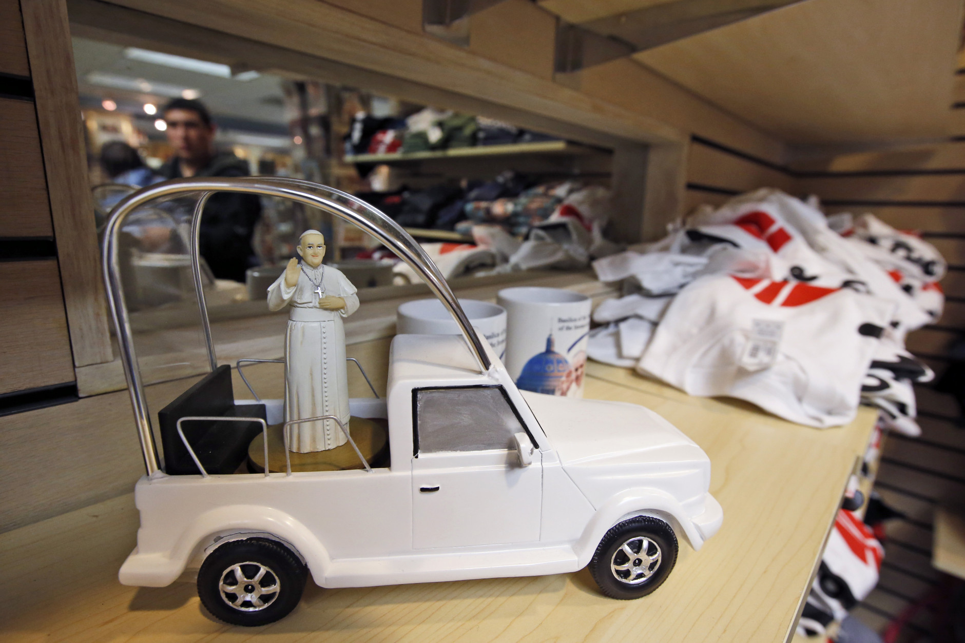 A musical popemobile with a likeness of Pope Francis in it, is for sale at The Basilica of the National Shrine of the Immaculate Conception gift shop in Washington, Tuesday, Sept. 22, 2015, in preparation for the upcoming visit by Pope Francis. (AP Photo/Alex Brandon)