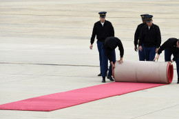 Members of the Armed Forces Full Honor Cordon from the Military District of Washington roll up the red carpet after a practice run for the arrival of Pope Francis, Tuesday, Sept. 22, 2015, at Andrews Air Force Base in Md. The Pope is spending three days in Washington before heading to New York and Philadelphia. This is the Pope's first visit to the United States. (AP Photo/Susan Walsh)