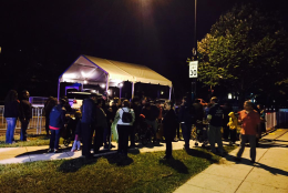 A small crowd gathers outside the Vatican Embassy at about 5 a.m. Thursday hoping to catch a glimpse of Pope Francis. (NBC Washington/Rick Yarborough)