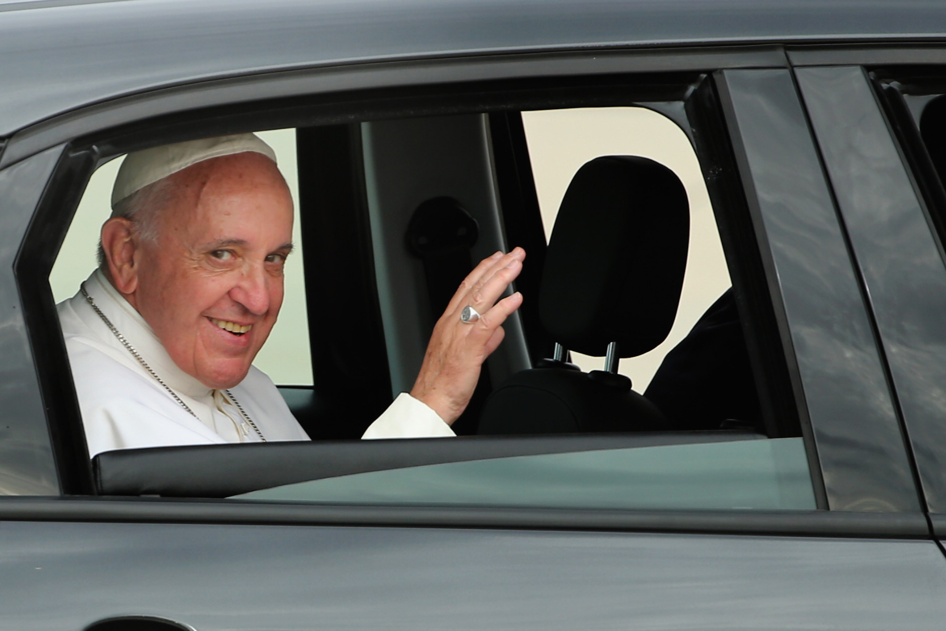 JOINT BASE ANDREWS, MD - SEPTEMBER 22:  Pope Francis waves from the back of his Fiat after arriving from Cuba September 22, 2015 at Joint Base Andrews, Maryland. Francis will be visiting Washington, New York City and Philadelphia during his first trip to the United States as pope.  (Photo by Chip Somodevilla/Getty Images)