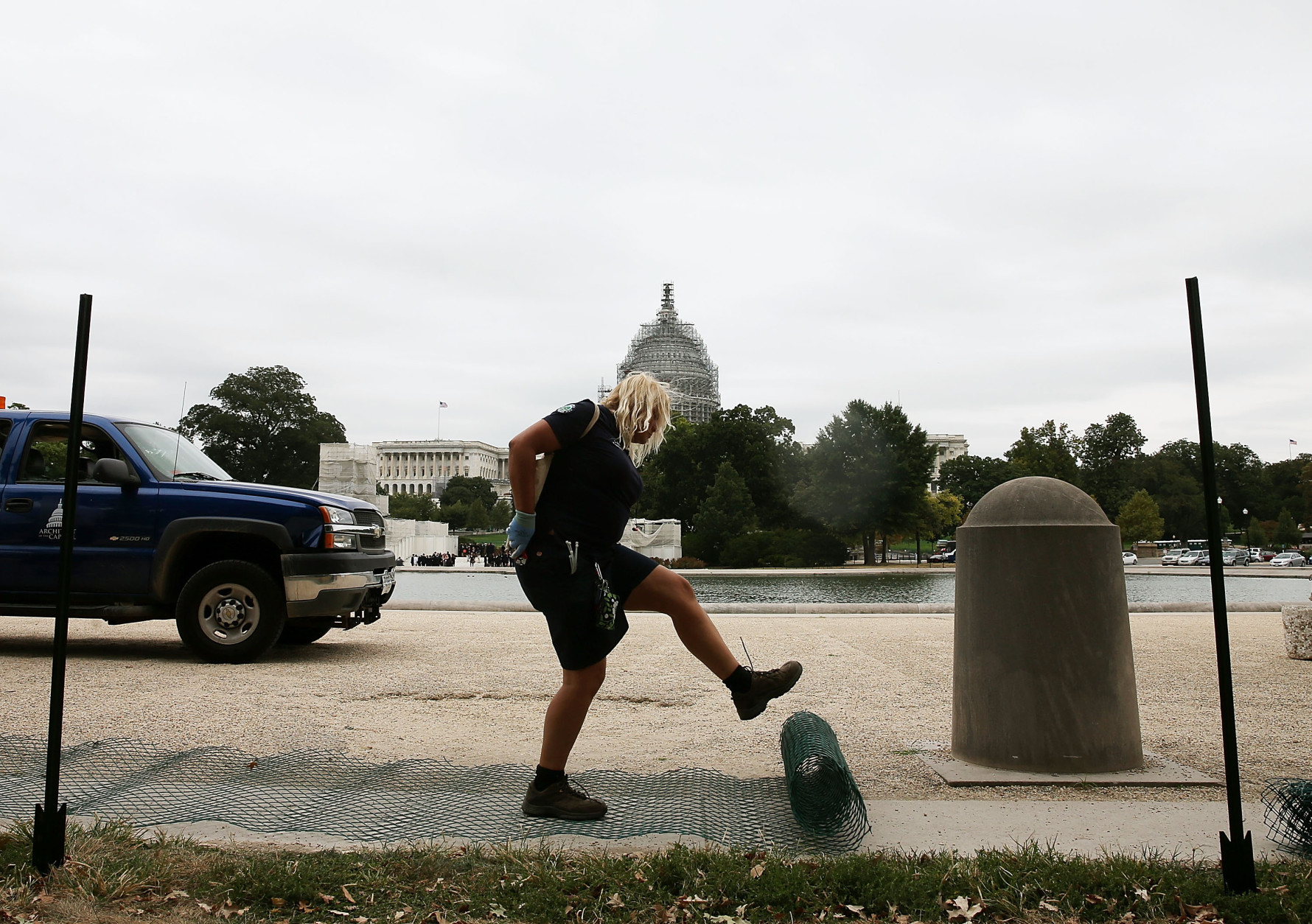 WASHINGTON, DC - SEPTEMBER 21: US Capitol grounds worker Lisa Gray unrolls crowd control fencing to be installed in preparation of Pope Francis' visit this week, September 21, 2015 in Washington, DC. Pope Francis will arrive in Washington on Tuesday to spend 3 days before he travels on to New York and Philadelphia. (Photo by Mark Wilson/Getty Images)