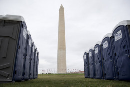 Portable toilets sit locked on the National Mall near the Washington Monument in Washington, Monday, Sept. 21, 2015, the day before Pope Francis arrives. Washington is bracing for the crowds hoping to get a glimpse of the Pontiff. (AP Photo/Carolyn Kaster)