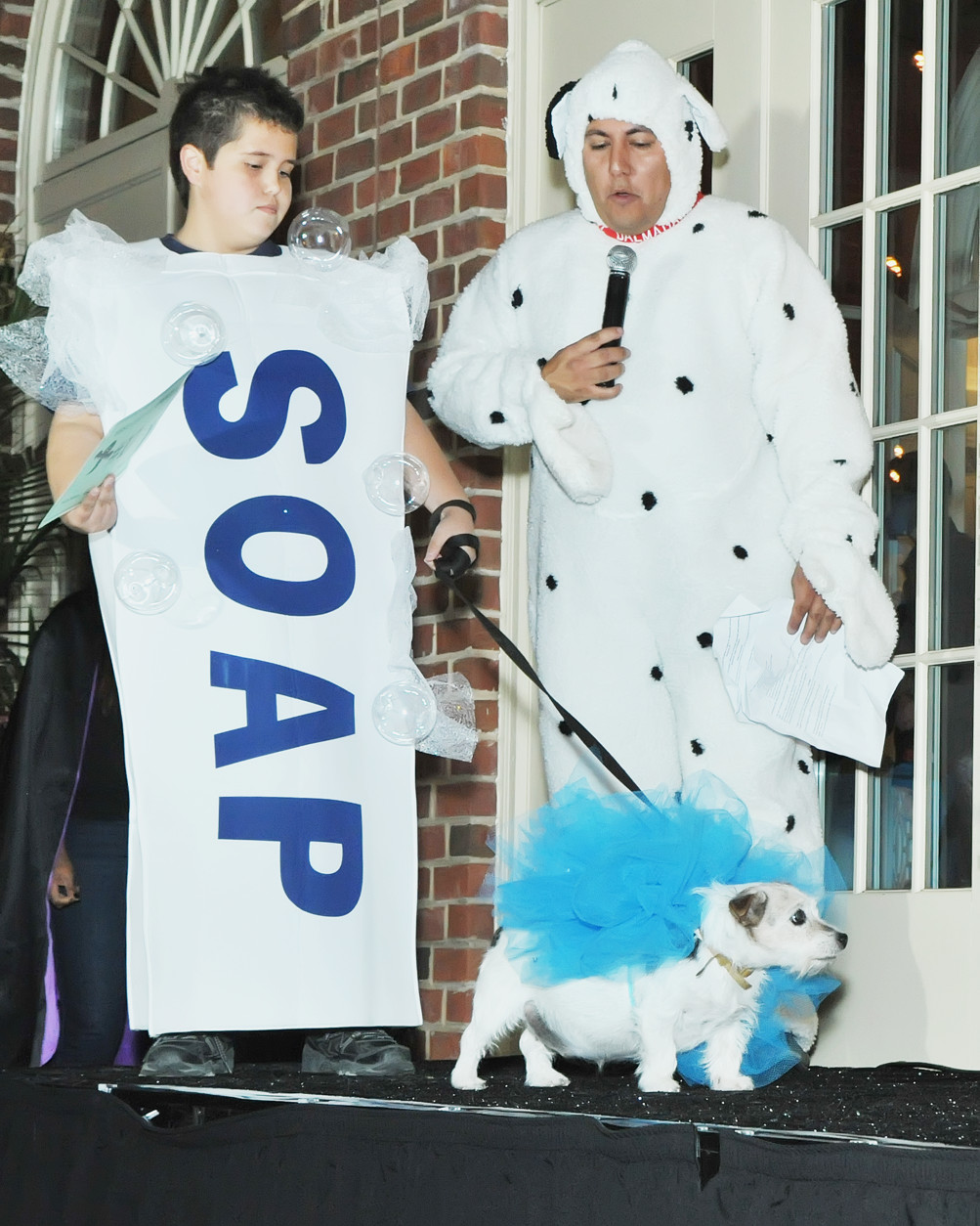 Gunner and his dog, Snuggles, dressed as a loofah. (Shannon Finney Photography)