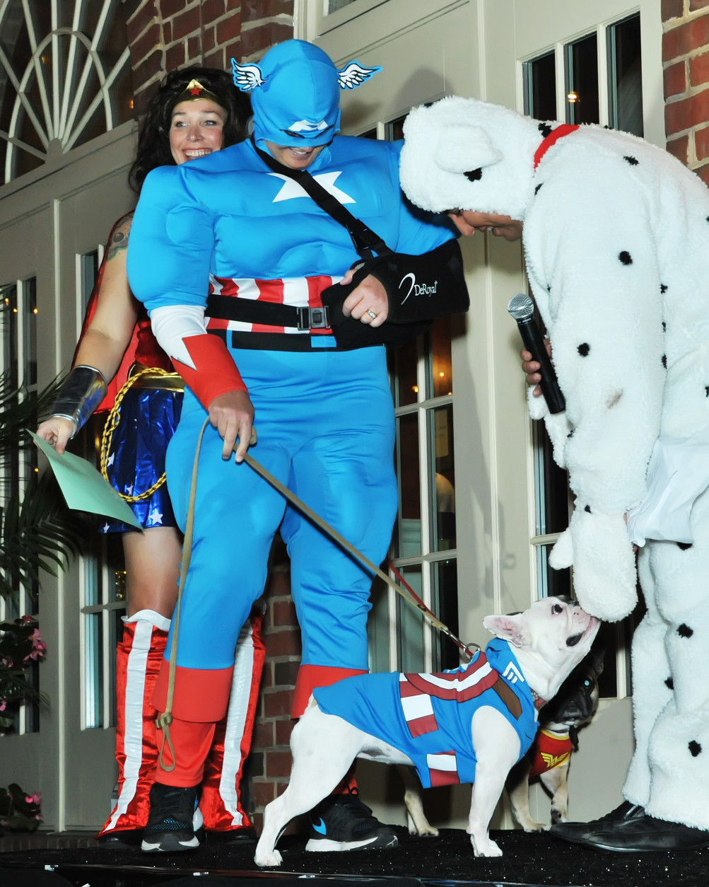 Canine Captain America greets competition host John Gonzalez. (Shannon Finney Photography)