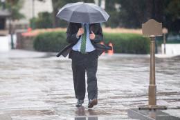 UNITED STATES - October 1: A man walks through the rain near the U.S. Capitol in Washington, on Thursday, Oct. 1, 2015. (Photo By Al Drago/CQ Roll Call)