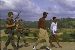 American soldiers guarding suspected members of the People's Revolutionary Army of Grenada during the US OP Urgent Fury invasion of the island feared a Cuban/Soviet military threat in the Caribbean after a Marxist coup.  (Photo by Matthew Naythons/The LIFE Images Collection/Getty Images)
