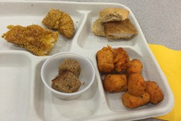 Clockwise from upper left: catfish, a chicken sandwich, sweet potato tots and banana bread. (WTOP/Michelle Basch)