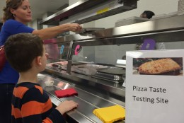 Moms, dads and kids also got to try four different kinds of pizza and were asked to vote for their favorite. The winner will be served in every Arlington school through the end of the school year. (WTOP/Michelle Basch)