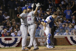 New York Mets' Daniel Murphy celebrates with teammate David Wright after hitting a two-run home run during the eighth inning of Game 4 of the National League baseball championship series against the Chicago Cubs Wednesday, Oct. 21, 2015, in Chicago. (AP Photo/David J. Phillip)