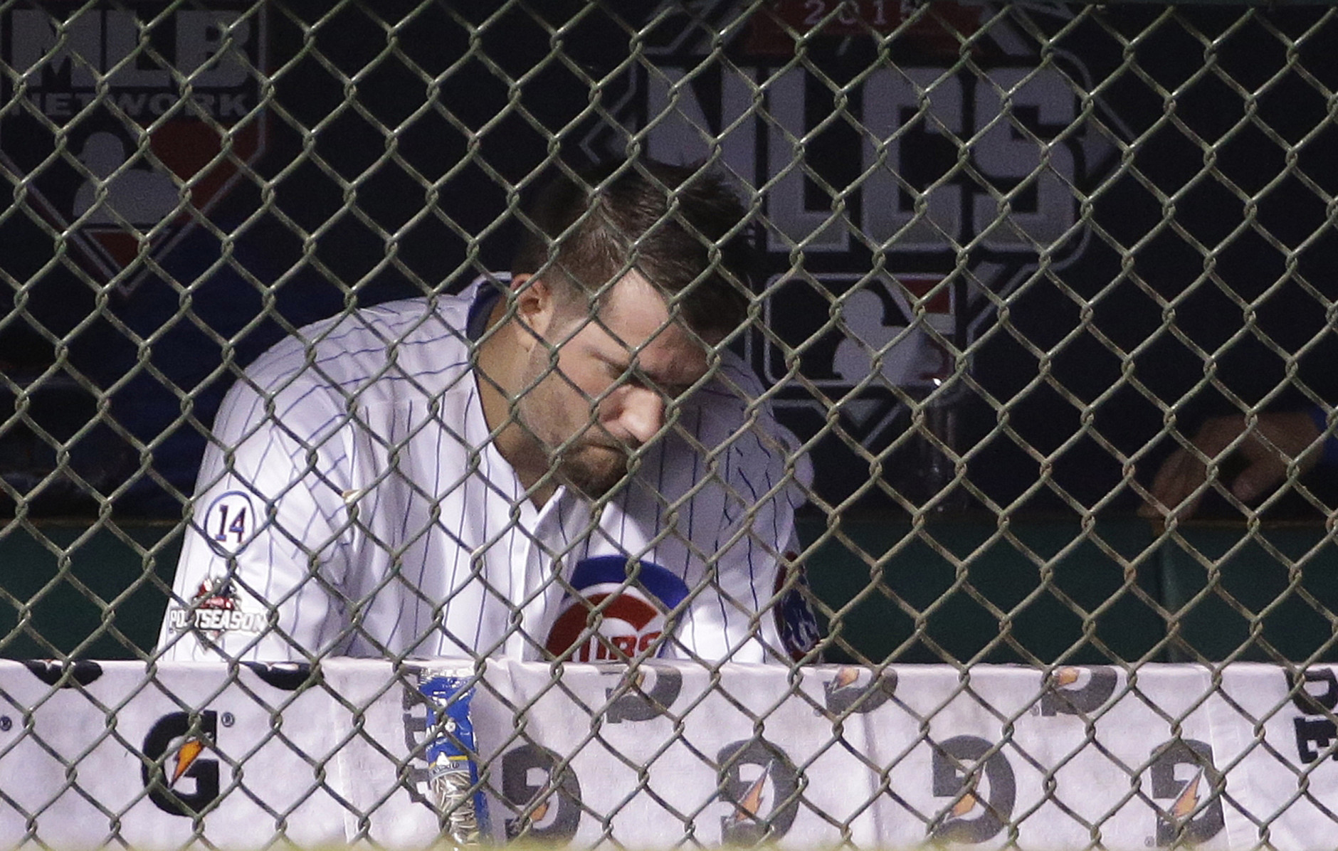 Chicago Cubs pitcher Jason Hammel sits in the dugout after being taken out of the game during the second inning of Game 4 of the National League baseball championship series against the New York Mets Wednesday, Oct. 21, 2015, in Chicago. (AP Photo/David J. Phillip)