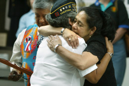 Priscilla Piestewa, right, mother of Army Spc. Lori Piestewa, hugs an unidentified woman during the Women in Military Service Memorial, Monday, May 26, 2003, at Arlington Cemetery in Arlington, Va. The memorial honored Spc. Piestewa, a Native American servicewomen who died during the Iraq war, and unveiled a new exhibit. (AP Photo/Lawrence Jackson)