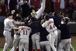 Boston Red Sox players celebrate after beating the St. Louis Cardinals 3-0 in Game 4 to sweep the World Series Wednesday, Oct. 27, 2004, in St. Louis. (AP Photo/Sue Ogrocki)
