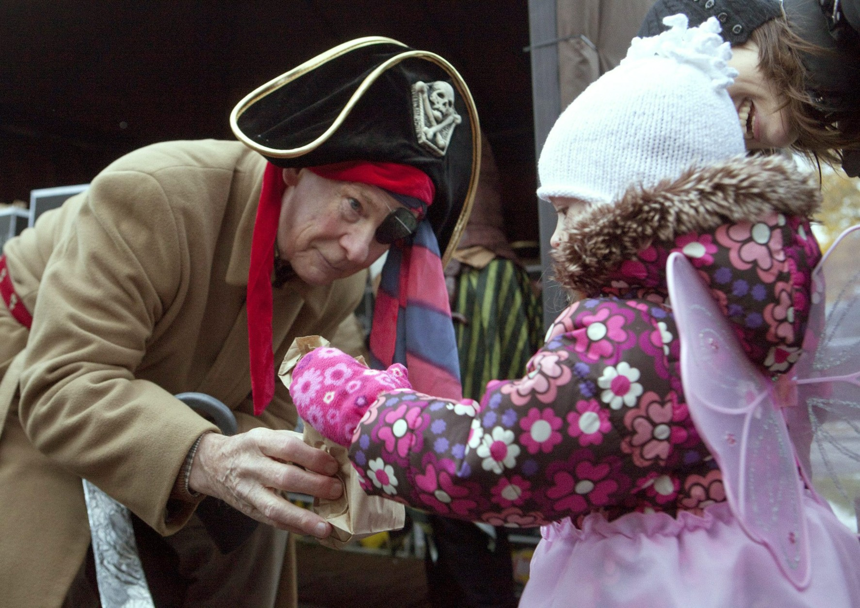 The Governor General of Canada David Johnston dressed as a pirate hands out candy to fairy Ella Statler at Rideau Hall on Halloween in Ottawa on Sunday, October 31, 2010. The Governor General's residence was open to the public for trick or treaters on Halloween  THE CANADIAN PRESS/Pawel Dwulit