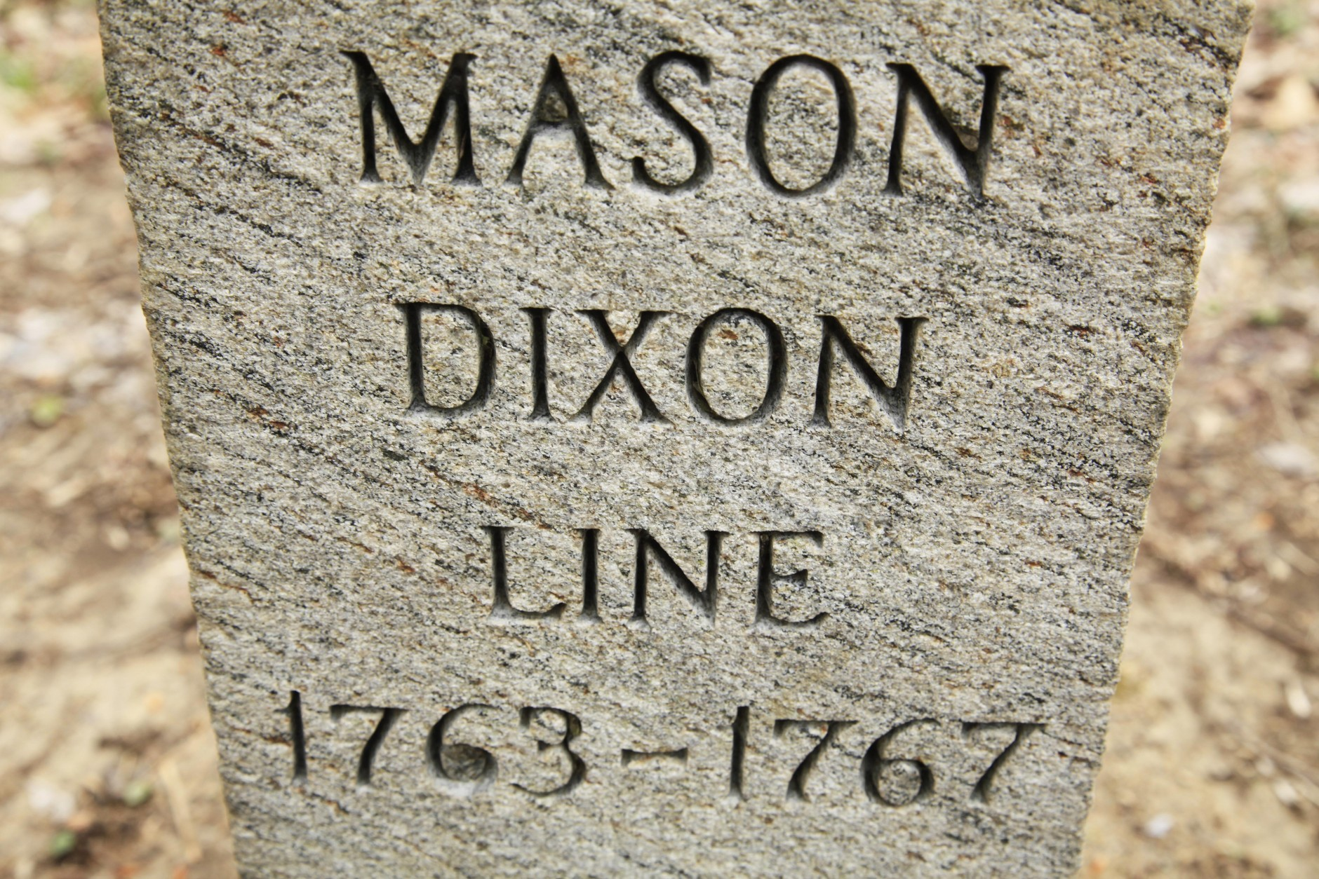 In this Friday, April 15, 2011, photo  in Newark Del., shown is a post marking the base point in the survey of Charles Mason and Jeremiah Dixon.  Mason and Dixon began their survey a century before the Civil War to settle a border dispute between Pennsylvania and Maryland.  (AP Photo/Matt Rourke)