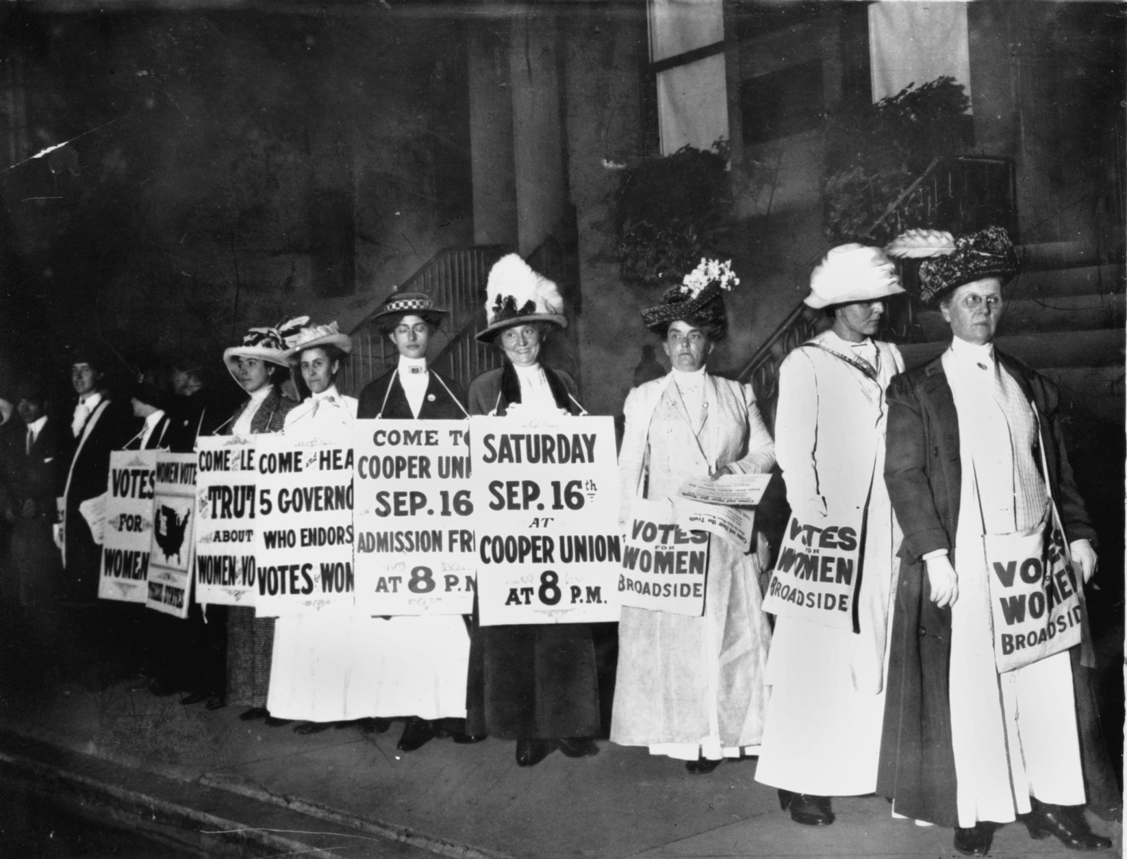 A line of women rally for women's suffrage and advertise a free rally discussing women's right to vote in Washington D.C. on Oct. 3, 1915.  (AP Photo)