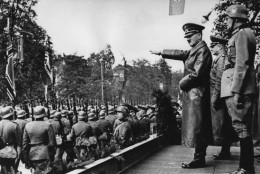 Adolf Hitler, front, salutes parading troops of the German Wehrmacht in Warsaw, Poland, on Oct. 5, 1939 after the German invasion. Behind Hitler are seen, from left to right: Army Commander in Chief, Colonel General Walther von Brauchitsch, new commandant of Warsaw, Lieutenant General Friedrich von Cochenhausen, Colonel General Gerd von Rundstedt, Colonel General Wilhelm Keitel. (AP Photo)