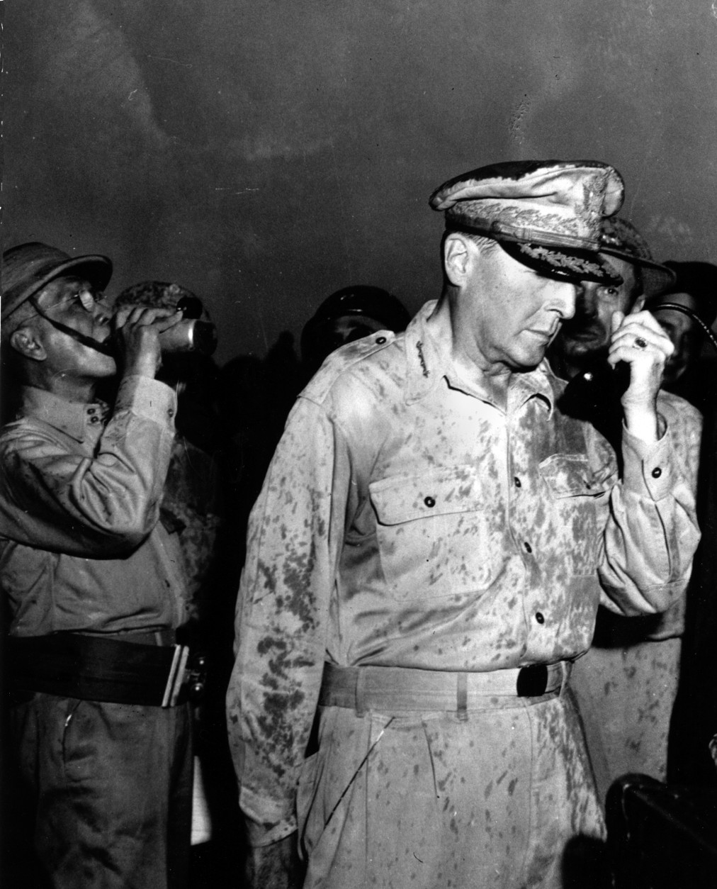 "Gen. Douglas MacArthur is seen on Leyte Island in the Philippines, October 20, 1944, during World War II.  He broadcasts to the residents ""I have returned.""  He also called on them to aid the American invasion forces. Standing to his left is Philippine President Sergio Osmena. (AP Photo)HC00408"