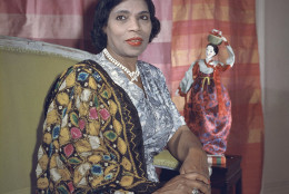 Singer Marian Anderson holds a Korean doll in her New York apartment, Aug. 5, 1958. The doll and the shawl she is wearing are gifts received on a trip to the Far East. Miss Anderson became a member of the United States delegation to the United Nations, which she sees as an opportunity to contribute to the mutual understandings of people. (AP Photo)