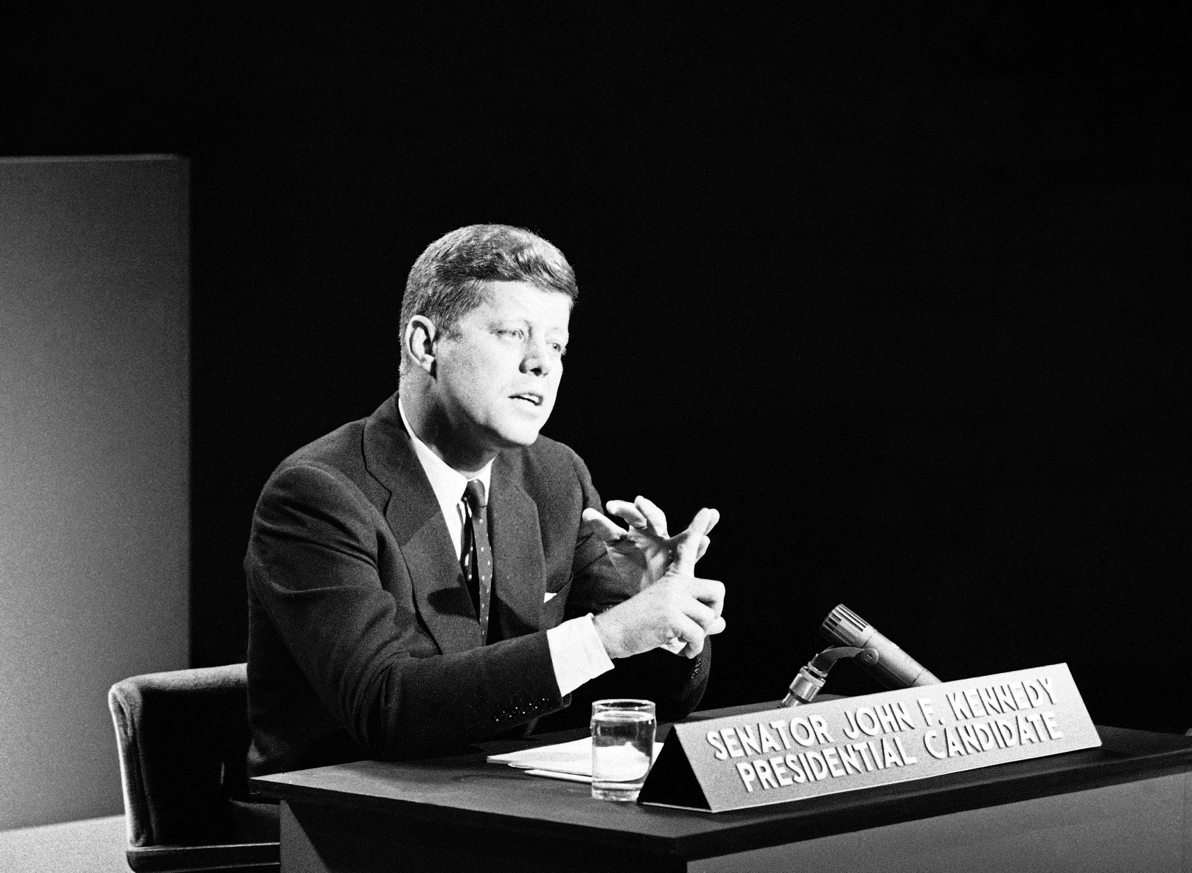 "Sen. John F. Kennedy keeps count with his fingers as he presses a point of view during a Philadelphia appearance on a news panel show ""Face the Nation"" on Oct. 30, 1960 in Philadelphia.  Kennedy carried his democratic presidential campaign into Pennsylvania in quest of the state's 32 electoral votes. (AP Photo/HG)"