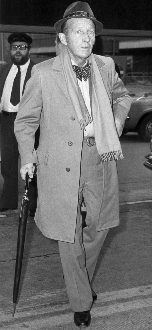 With swinging step, crooner Bing Crosby leaves Heathrow  Saturday March 1, 1975 for his Los Angeles home. Bing has been in Britain for nearly two weeks, recording a pair of comeback LPs in a West End Studio, to celebrate his 50th year in show business. (AP Photo/UKPA