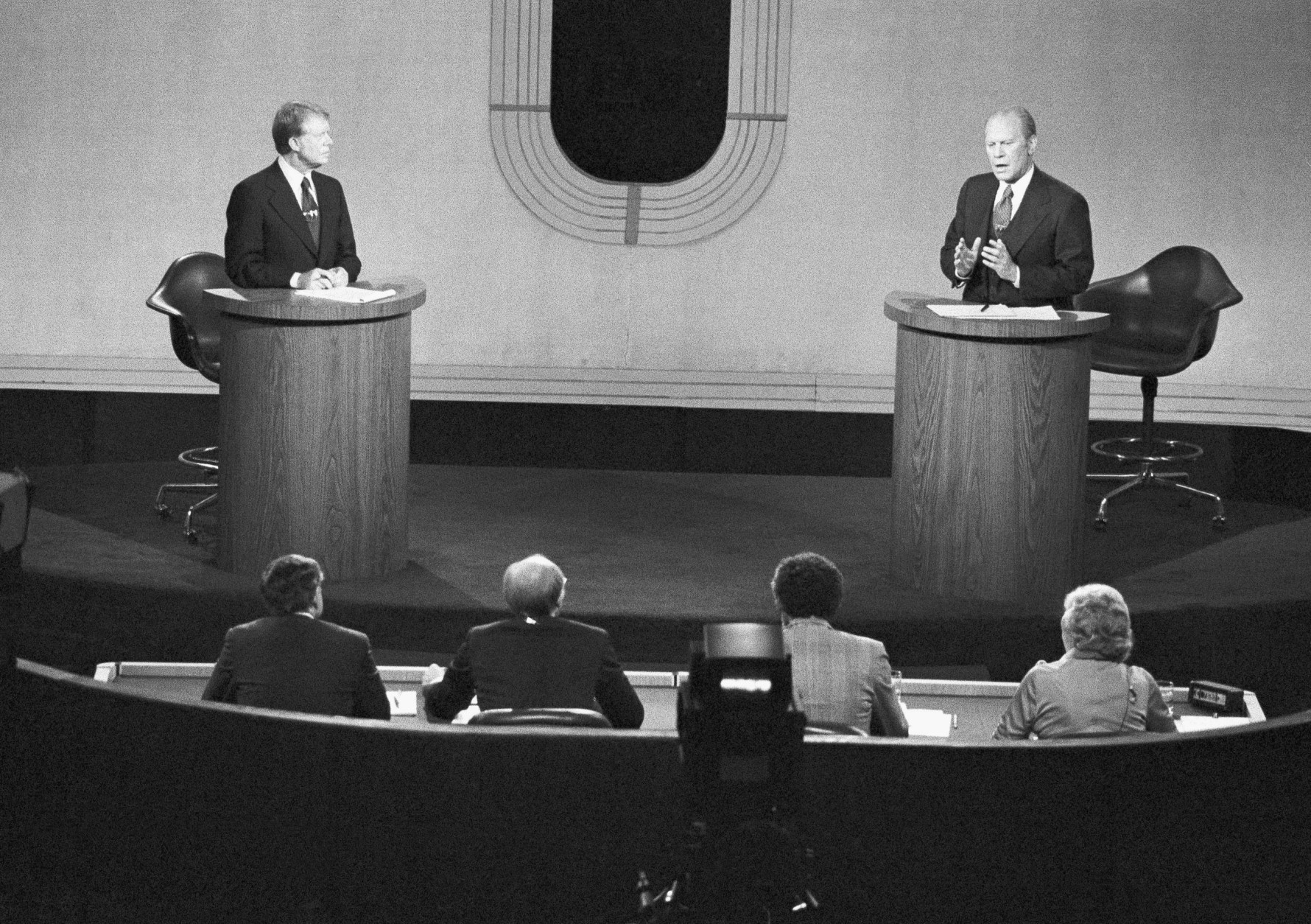 President Gerald Ford, right, emphasized a point during his second debate with Jimmy Carter, left, at Palace of  Fine Arts Theater, Wednesday, Oct. 6, 1976, San Francisco, Calif. (AP Photo)