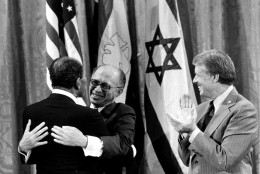 Egyptian President Anwar Sadat, left, and Israeli Prime Minister Menachem Begin, embrace as U.S. President Jimmy Carter looks on, September 18, 1978, during a White House announcement of a Middle East peace agreement reached at the Camp David Summit earlier this year.  Sadat and Begin were named joint winners in the 1978 Nobel Peace Prize in an announcement Friday, October 27, from officials in Oslo, Norway.  (AP Photo)