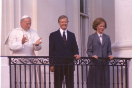 Pope John Paul II stands on the balcony of the White House with  President Jimmy Carter and first lady Rosalynn Carter in Washington, D.C., on Oct. 6, 1979.  (AP Photo)