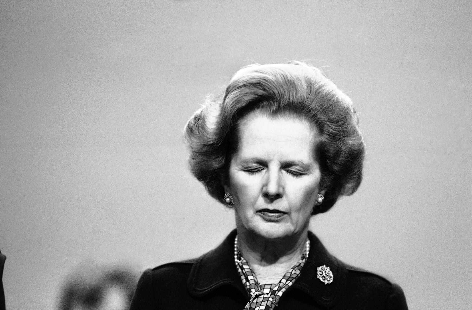 Britain?s Prime Minister Margaret Thatcher stands with her eyes closed during a moments silence for victims of the bomb blast at the Grand Hotel in Brighton, England, Oct. 12, 1984 at the Conservative Party Conference. Twenty-two members of Mrs. Thatcher?s government were staying at the Grand when the bomb went off. Premier Thatcher was uninjured in the blast however windows in her suite we blown out and her bathroom badly damaged. (AP Photo/Peter Kemp)