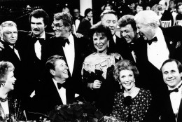 """President Ronald Reagan and first lady Nancy Reagan are surrounded by Hollywood friends, Dec. 1, 1985 in Burbank, Calif., after the taping of a CBS-TV special honoring the president titled """"All-Star Party For Dutch Reagan"""". Seated, from left: Maureen Reagan, the president, Mrs. Reagan and Michael Reagan. Standing, from left: Frank Sinatra, Burt Reynolds, Dean Martin, Eydie Gorme, Vin Scully, Steve Lawrence, and Paul Keys. (AP Photo/Scott Stewart)"""
