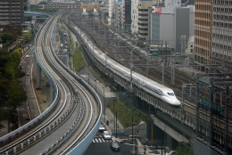 In this Sept. 24, 2014 photo, a Shinkansen bullet train heads for Tokyo Station on the Tokaido Main Line in Tokyo. Japan launched its bullet train between Tokyo and Osaka 50 years ago Wednesday, Oct. 1, 2014. (AP Photo/Shizuo Kambayashi)
