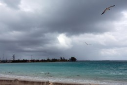 Skies begin to darken as Hurricane Joaquin passes through the region, seen from Nassau, Bahamas, early Friday, Oct. 2, 2015. Hurricane Joaquin dumped torrential rains across the eastern and central Bahamas on Friday as a Category 4 storm. (AP Photo/Tim Aylen)