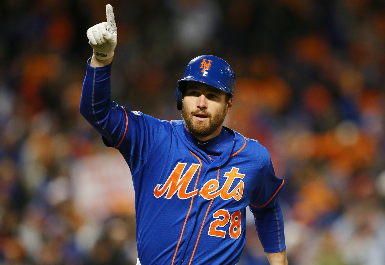 New York Mets' Daniel Murphy celebrates his home during the first inning of Game 1 of the National League baseball championship series against the Chicago Cubs Saturday, Oct. 17, 2015, in New York. (AP Photo/Elsa Garrison, Pool)