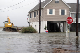 Flood waters enveloped this neighborhood in the Strathmere section of Upper Township N.J. on Friday Oct. 2, 2015. Despite forecasts showing the impending Hurricane Joaquin may move out to sea and not directly strike New Jersey, crews along the shore were nonetheless taking precautions against flooding from a wind and rainstorm that preceded Joaquin and that was causing some flooding in southern New Jersey on Friday. (AP Photo/Wayne Parry)