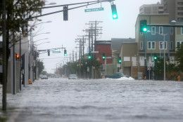 Cars make their way down a flooded street in Atlantic City, Saturday, Oct. 3, 2015. A coastal flood warning for the state is due to remain in effect until Sunday evening. (Lori M. Nichols/NJ.com via AP)  PHILLY METRO OUT NEWS; MANDATORY CREDIT, TV OUT, NO SALES, MAGS OUT