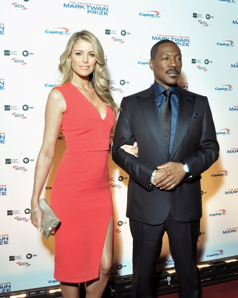 Honoree Eddie Murphy is seen here on the red carpet at the Kennedy Center for the Performing Arts on Oct. 18, 2015 with partner Paige Butcher.  (Courtesy Shannon Finney, www.shannonfinneyphotography.com)